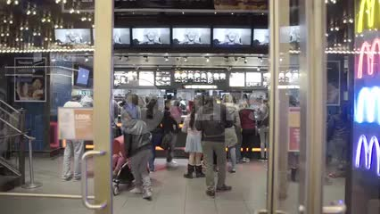 people on line at McDonald's - inside 42nd street location off Times Square in Manhattan