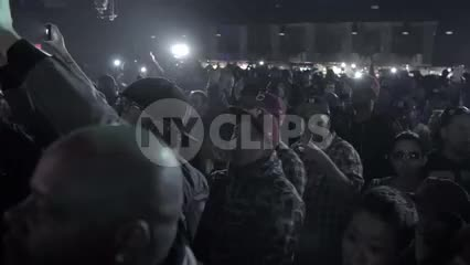 crowd watching hip hop show in slow motion