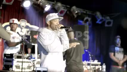 Prodigy of Mobb Deep rapping on stage in slow motion