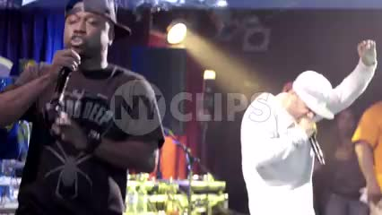 Mobb Deep rapping at show on stage with audio