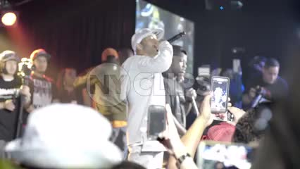 Prodigy of Mobb Deep onstage rapping at show - concert with fans holding up smartphone cameras
