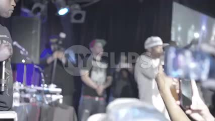 fan in crowd recording with smartphone cam - Prodigy and Havoc of Mobb Deep at rap show