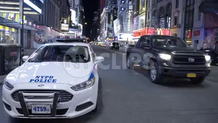 police car parked on the street at night off Times Square