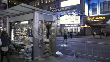 newsstand and exterior subway entrance on 42nd street at night
