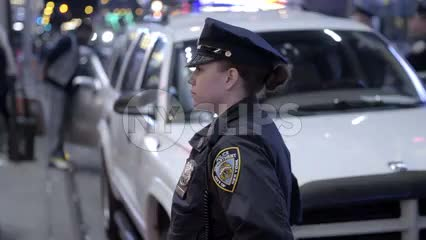 female police officer - NYPD cop in uniform off Times Square at night