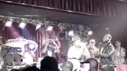 Steele and Tek of Smif n Wessun onstage rapping at live hip hop show in slow motion