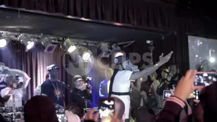 Steele of Smif n Wessun rapping on stage at hip hop show with crowd watching