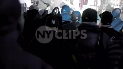 fans in audience with Yankee jacket watching Smif n Wessun rap show live in concert - crowd facing stage