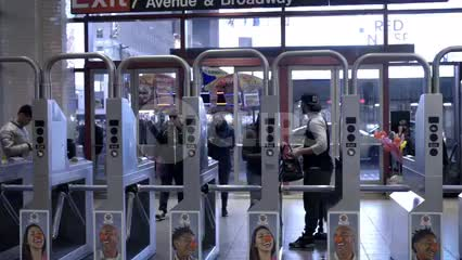 people looking for money and metro cards to enter Times Square turnstiles at night