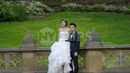 beautiful couple married in Central Park - posing for picture in summer wedding
