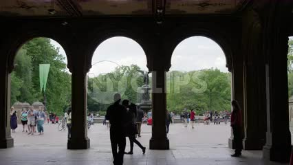 silhouette of couple kissing under Bethesda Terrace - photographer taking picture in Central Park