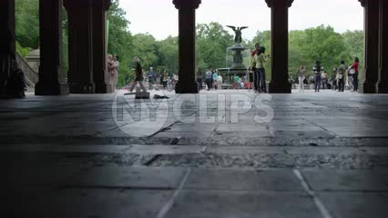 rising from floor view of walkway underneath Bethesda Terrace in Central Park in summer