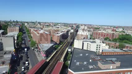 aerial of elevated subway train tracks in the Bronx