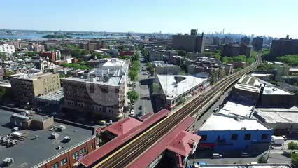 flying over subway tracks and gritty street in the Bronx - aerial