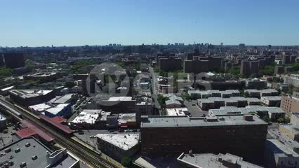 aerial over houses in the Bronx with public housing projects