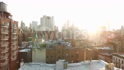 aerial of downtown with Manhattan skyscrapers at sunset - Chinatown buildings