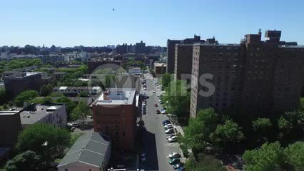 The Bronx with Manhattan skyline on horizon - aerial of housing projects