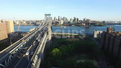 aerial of Manhattan Bridge and East River on beautiful sunny day - cars driving to Brooklyn