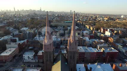 aerial flying through church steeples in the Bronx