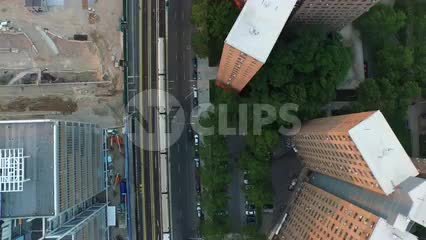 1 train passing through Harlem on elevated track - aerial of subway in Uptown Manhattan