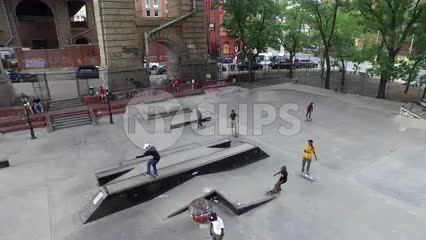 high view of kids skating in park