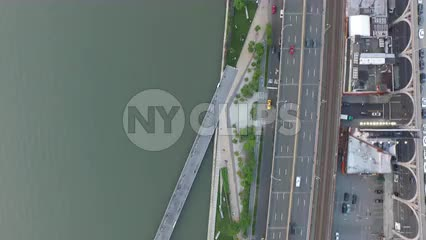 aerial of taxicab driving in traffic on Westside Highway by Hudson River