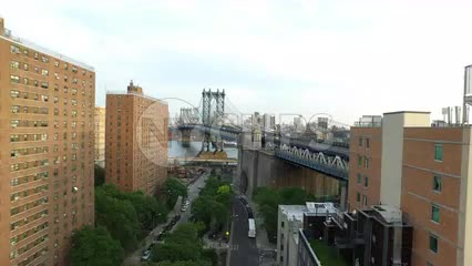 aerial view backing up from Manhattan Bridge to affordable housing buildings in Lower East Side neighborhood
