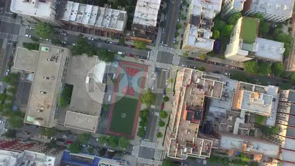 circling over basketball court in Harlem - aerial of courts uptown