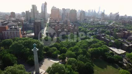 aerial over Prison Ships Martyrs' Monument at Fort Greene Park in Brooklyn with Manhattan skyline in background