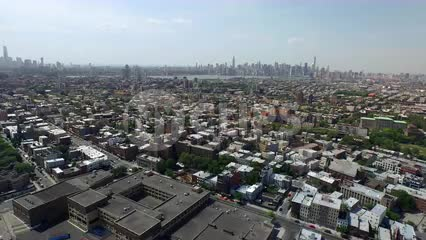 aerial of Brooklyn field with Manhattan skyline on horizon
