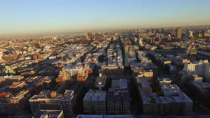buildings in Harlem from aerial view in late afternoon