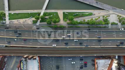 aerial of cars driving in traffic on Westside Highway by Hudson River - high up over Manhattan road in NYC