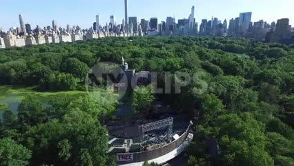 aerial of Central Park trees and Manhattan skyscrapers on summer day in NYC