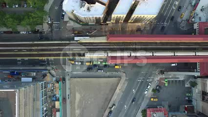 aerial of Harlem elevated subway track - looking down on 1 train Uptown NYC