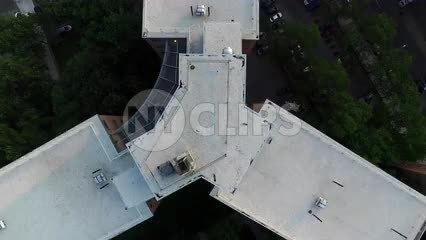 lifting off rooftop of Harlem projects - aerial above Uptown building