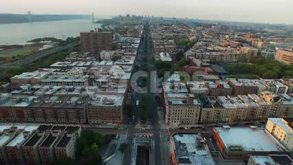 aerial view backing up from buildings in Harlem Uptown in NYC