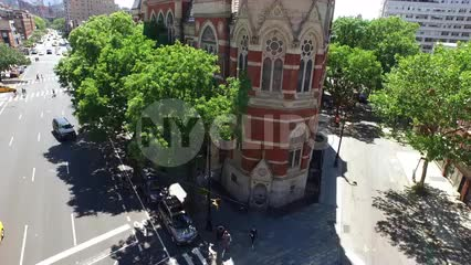 rising aerial of Jefferson Market Library in Greenwich Village - famous clock tower building in Downtown Manhattan