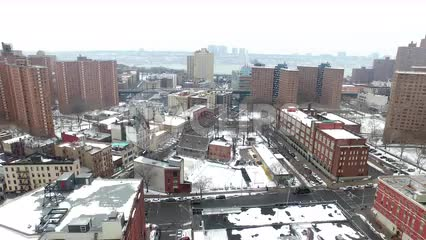 aerial moving over housing projects covered in snow in winter in NYC