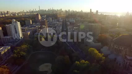 Uptown Manhattan trees from aerial view with skyline in background at sunset in NYC