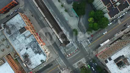 aerial of 1 Train entering tunnel - overhead view of subway and project building - moving over Harlem in NYC