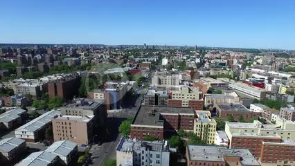 aerial of housing projects, low lying houses and buildings in poverty stricken section of the Bronx