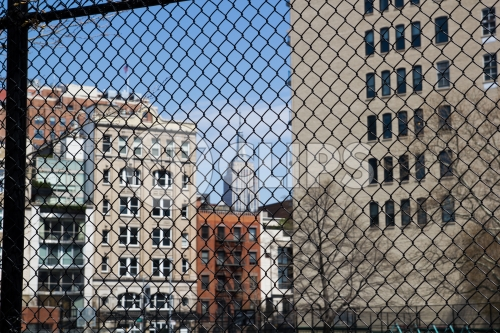 Empire State Building view through fence