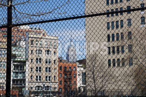Empire State Building seen through fence