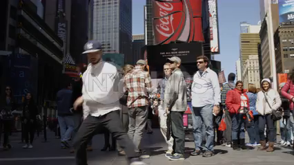 beboy doing windmills in Times Square - breakdancing in slow motion in 4K NYC