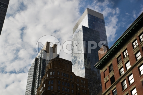 skyscraper towering over buildings in Manhattan