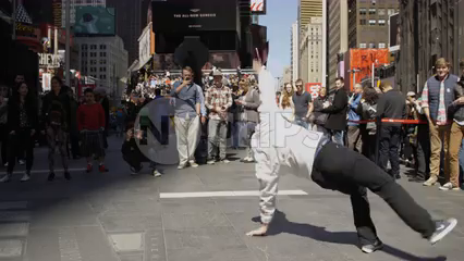 breakdancer doing swipes in Times Square before a crowd - 4K in slow motion NYC