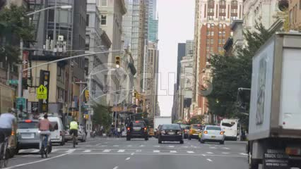 driver pov on summer day - man on bicycle on 6th Avenue