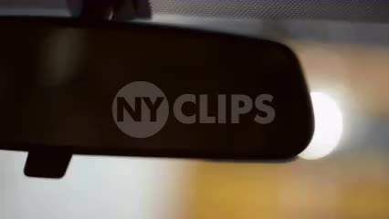 rearview mirror from driver pov - close up