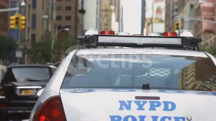 tailgating NYPD police car driving close - rear - cops on road in Manhattan