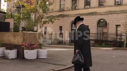 elderly Orthodox Jewish man walking down street in Williamsburg Brooklyn on Fall day in NYC